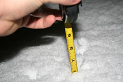 Measuring 6 inches of snow in North Tacoma